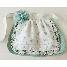 vintage apron by charlaanne on Etsy Aw, I still have mine from when I was a little girl. Love this one.