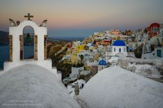 VIEW OF OIA In Oia, at sunrise, all kind of amazing photography opportunities await.  I know the thought of waking up early is daunting but take it from me, it's worth it.  You get all the beauty with none of the tourists. And the sky is unbelievable.  Oia is a hard place to photograph during the day due to the very strong sunlight reflecting off the white buildings. But at sunrise the lighting is soft so you can se all the pretty colors around Oia.