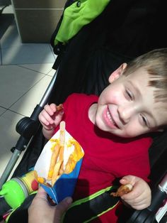 I love this little guy's smile. Of course, I am pretty sure he's smiling because he just got some fries from French Fry Heaven. :0)