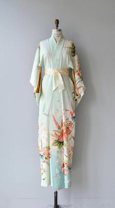 Vintage 1950s silk kimono in celadon green with summery floral print and wide cream sash belt. ✂-----Measurements fits like: free size bust: free waist: free length: 61 brand/maker: n/a condition: a faint stain on one arm, see close up photo ✩ layaway is available for this item to ensure a good fit, please read the sizing guide: http://www.etsy.com/shop/DearGolden/policy ✩ visit the shop ✩ http://www.DearGoldenVintage.etsy.com