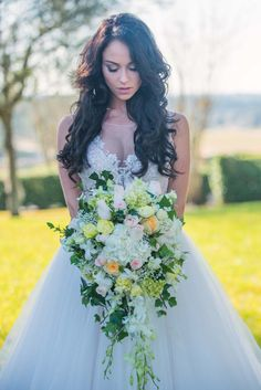 Cascading Bridal Bouquet by Sherwood Florist - Fairytale Wedding at Southern Hills Plantation Club - Photo by Napoleoni Photography, LLC - Click pin for more - www.orangeblossombride.com