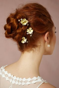 updo braid bun with flower pins