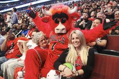 Chicago Bulls mascot Benny the Bull gets the grandmother-granddaughter duo onto the jumbotron, then sprays the crowd with silly string.