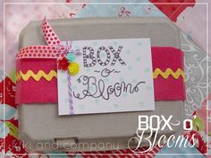 Box o' Blooms Baby Gift. Fill the egg carton with hair flowers. #baby #gift #diy