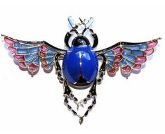 Scarab beetle. May Bugs belong to the Scarab family, revered for millenia in Ancient Egypt. Unlike this be-jewelled artifact, real May Bugs live for only about 5 or 6 weeks.