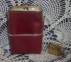 vintage cigarette lighter and cigarette case