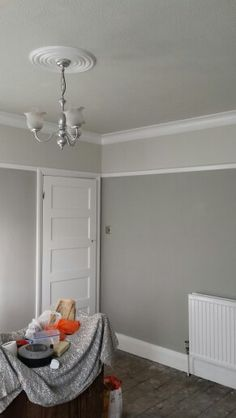 Grey living room. Dulux misty mountain, pebble shore and white cotton satinwood.