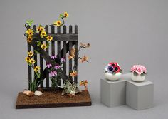 Roses, Anemones and an aged gate-Miniature flower arrangements made by Sandra Manring