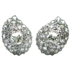 Cartier GIA Cert Diamond Platinum Ear Clips   From a unique collection of vintage clip-on earrings at https://www.1stdibs.com/jewelry/earrings/clip-on-earrings/