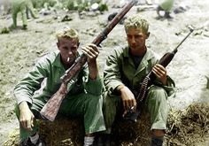 Two Marines compare Japanese rifle with American carbine. Okinawa - May 1945(rudeerude) Re-Color