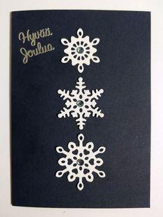Joulukortti lumihiutaleilla