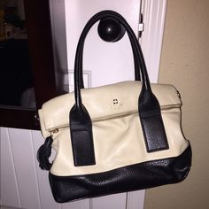 Kate Spade purse! ♠️ I have an adorable Kate Spade purse for sale, the only thing wrong with it is the tassel is a little chewed up (my dog's fault), but you can't tell it there unless you stare really hard. Comes with shoulder strap. Other than that great condition! NO TRADES. kate spade Bags Shoulder Bags