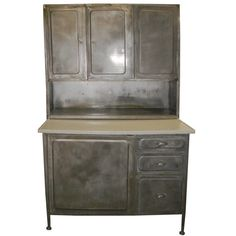 Steel and Porcelain Hoosier Cabinet by unearthedgallery on Etsy