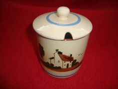 """Torquay Motto Cottage Ware Watcombe Pottery Preserve Pot:  Produced by the Watcombe Pottery in the early part of the 20th century , the piece is of cylindrical form and features a cottage decoration to the body with the words """"To have a friend is to be one"""" . The pot is fully marked to the base.  Dimensions: 11 cm x 8 cm - Condition: Excellent - Stock Number: B018 - Price: £20.00"""