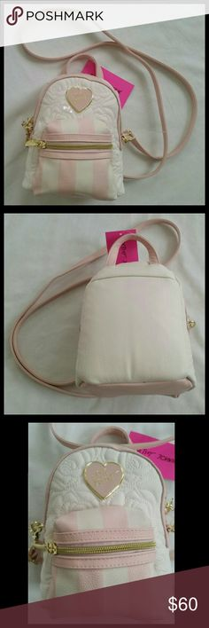 FINAL PRICE! NWT Betsey Johnson mini backpack FINAL PRICE!  This adorable mini backpack is the perfect accessory to complete your outfit!  Comes is a beautiful white and blush pink color scheme on exterior. Has a functional exterior zipper pocket and a large zip compartment. Has long strap to wear on shoulder and a small handle at top.  NWT. Never been used. Betsey Johnson. Betsey Johnson Bags Backpacks