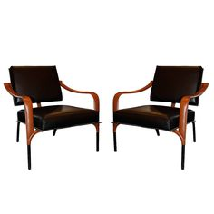 Jacques Adnet Pair of Leather Lounge Chairs, France, circa 1955 | From a unique collection of antique and modern chairs at https://www.1stdibs.com/furniture/seating/chairs/