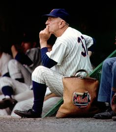 """Mets Manager Casey Stengel closely studies the action during a 1963 game. After the last game of the Mets' inaugural season, in which lost 120 games, Stengel told his assembled team that the season was a """"team effort"""". New York Yankees Baseball, Sports Baseball, Baseball Players, Casey Stengel, Last Game, Baseball Photos, Mlb Teams, Ny Yankees, Chicago White Sox"""