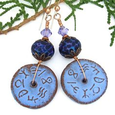 The rustic terracotta ceramic discs and speckled lampwork beads used as the focals of the DAWN OF TIME handmade earrings look as if they have spent eons lying in an ancient site, just waiting to be unearthed and worn again.