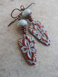 bro·cade brəˈkād/ noun a rich fabric, usually silk, woven with a raised pattern, typically with gold or silver thread.  Awesome polymer clay charms, handcrafted by a very talented etsy artisan, are complemented by artisan-made lampwork beads. Copper rondelles and bead caps add the final touch. Suspended from copper earwires, these lightweight earrings measure about 2 3/8 from end to end. Beautiful -- and perfect year-round