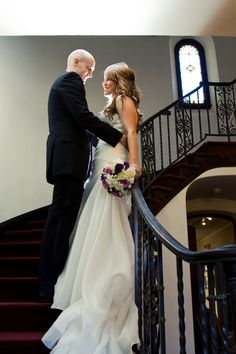 Wedding photos on the staircase of the Muckenthaler Mansion