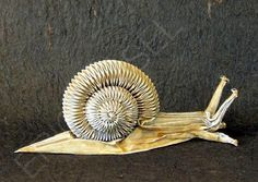 Eric Joisel (French origami master). Snail. Made from a wet-folded rectangular paper.