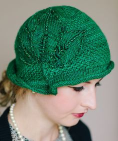 Knitting Pattern for Daisy Cloche (not free) This cloche hat with pleated rolled brim, textured stitch, and leaf motif knit separately was inspired by the character The Hon. Daisy Dalrymple from the mystery series created by author Carola Dunn. One of the 20 patterns in  A Head For Trouble: What To Knit While Catching Crooks, Chasing Clues, and Solving Murders (20 Hats & Adornments Inspired by Lady Detectives of the Roaring Twenties).