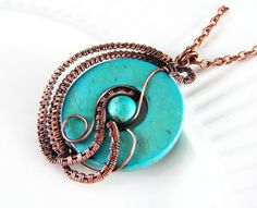Wire Wrapped Pendant Turquoise and Copper Jewelry Wire Wrapped Jewelry Copper Necklace Free Form Turquoise Necklace Copper Wire Donut Bead  This beautiful wire wrapped pendant is made from copper wire that has been hand-forged into an attractive free form design. Wire wrapped in more copper and accented with pretty genuine stones of turquoise. Pendant is set on a copper chain. Finished pendant has been oxidized and hand polished. Although I strive to make each one exactly alike, they are…