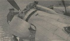 """Secret Passage."" Mechanics access the engine of a PanAm B314 flying boat from a hatch in the cowling. Circa 1940."