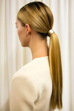 Sleek ponytails were sent down the runway at Wes Gordon Spring 2015. See all the best beauty looks from the runways here.