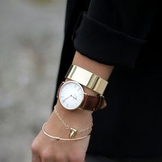 .I have this gold molar on a necklace. I love the mixture of her wrist. Classic and edgy!