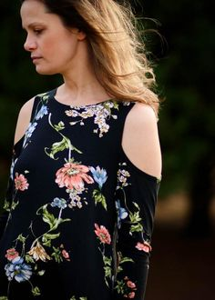 Love the black and pastel floral pattern on this cold shoulder top!