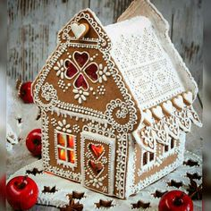 What a beautiful gingerbread house! Delicate royal icing piping and melted sugar windows. So elegant The top 10 most inspirational gingerbread house designs you've ever seen will get you motivated to make your own incredible gingerbread house. Gingerbread House Designs, Gingerbread Village, Gingerbread Decorations, Christmas Gingerbread House, Noel Christmas, Christmas Baking, Christmas Treats, Christmas Cookies, Christmas Decorations