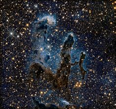 This NASA Hubble Space Telescope image, taken in near-infrared light, transforms the pillars into eerie, wispy silhouettes, which are seen against a background of myriad stars. Some of the gas and dust clouds are so dense that even the near-infrared light cannot penetrate them. - Credit: NASA/ESA/The Hubble Heritage Team (STScI/AURA)