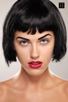 Short Hairstyles How To: This is a short bob hairstyle with full short bangs, parted at the crown. Flat brush, flat iron, smoothing gel, and a light hold hair spray.