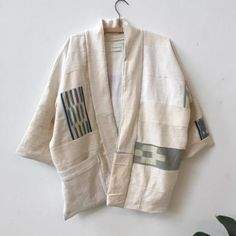 Stunning one of a kind, patchwork kimono coat. Made entirely from our scrap pile. It features all handwoven vintage textiles from West Africa. Mostly un dyed natural white cottons with occasional patches of Baoule, ikat from Cote d'Ivoire. Mens Quilted Coat, Modern Kimono, Kimono Coat, Batik Fashion, Denim Jacket Men, Vintage Textiles, Cool Fabric, West Africa, Jackets