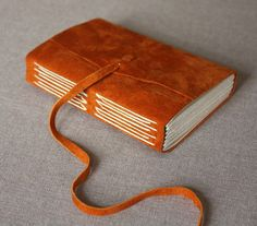 Italian Longstitch journal with rust orange suede cover Handmade Journals, Handmade Books, Hardcover Sketchbook, Leather Bound Journal, Leather Books, Book Binding, Wedding Guest Book, Leather Cover, Handicraft