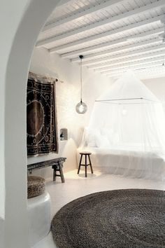 1. Really awesome rug hanging on wall by stick. 2. Bench. 3. Rug on floor. 4. Lamp! 5. Airy bed canopy. Yes.