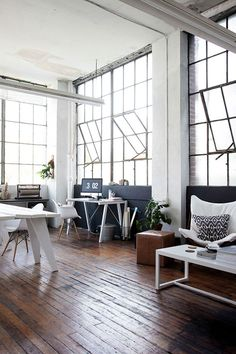 Beautiful modern loft space. Home renovation inspiration idea. Urban design. Hardwood. White. Monochrome. Minimalism.