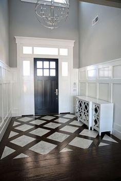Соединение двух видов покрытия четко зонирует интерьер прихожей. Для этого можно применять плитку, реалистично имитирующую дерево