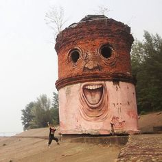 """hahah Russian street artist Nikita Nomerz turns derelict buildings into faces. """"I have been called an underground artist, but if you're doing street art you've not underground. You're already on everyone's mind, even if you paint on abandoned rubbish and only a couple of homeless people see your work. It is public art. It would be nice if people started paying more attention to what is around us."""""""