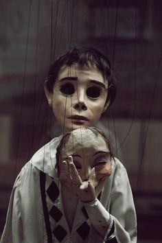 The boy was like a puppet; always wearing a mask to hide what he was feeling and always did as he was told. The strings cut into his wrists, and the little fight in him said to keep going, but his mind told him to give up and conform to fit society.