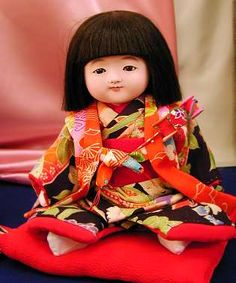 """""""Ichimatsu dolls"""" are traditional Japanese dolls representing boys/girls in Kimono.  This one was made by master Toko Shokansai.  His father was one of the first-class doll makers who made 58 """"friendship dolls"""" sent to the U.S in 1927 for a good will exchange;  the U.S sent 12,000+ """"blue-eyed dolls"""" to Japan."""