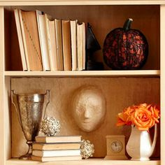 Ghosts in the Bookcase Halloween Project~ create 3-D phantoms from papier-mache, then position them to look like they're emerging from the back of a bookcase or wall.