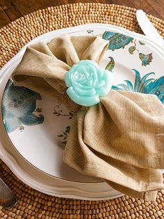 Dress up plain napkin rings with resin embellishments. We used a mold designed for fondant to create these stylish flowers.