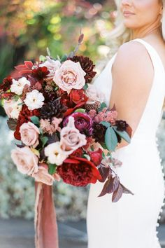 Bride, Heather's bouquet was filled with red and burgundy flowers. Photo: @taralynnlawtonphoto Getting Married, Wedding Planner, Floral Wreath, Just Say No, Burgundy Flowers, The Dreamers, Flower Arrangements, Wedding Flowers, Bouquet