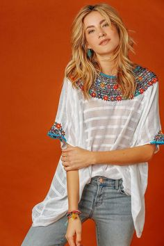 Dressed up or down, you'll want to wear the Guatemala Top all over town! This breezy cotton blouse features a chic embroidered neck, a relaxed bodice, and short sleeves. Unlined. As seen on The Salty