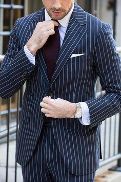A blue pinstripe suit is your deal making, power suit. It requires confidence to wear but projects the same. Here's how to wear a blue pinstripe suit. Modern Mens Fashion, Mens Fashion Blog, Suit Fashion, Cheap Fashion, Womens Fashion, Fashion Socks, Best Suits For Men, Cool Suits, Mens Suits