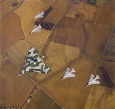 Beauty: A Vulcan B2 XH561 of 50 Squadron, RAF Cottesmore, leads four Lightning F6s during ...