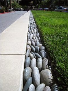 Top 50 Best River Rock Landscaping Ideas - Hardscape Designs Discover a tranquil reminder of rushing water, with the top 50 best river rock landscaping ideas. Explore backyard and front yard outdoor hardscape designs. Rock Edging, Driveway Edging, Lawn Edging, Stone Edging, Rock Border, Driveway Ideas, Border Edging Ideas, Sidewalk Edging, Grass Edging