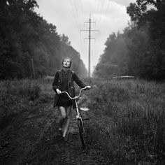 Photo by: Alex Mazurov In the rain, walking her bike through the mud, maybe even singing a song. Bike Photography, People Photography, Fine Art Photography, Portrait Photography, Artistic Photography, Amazing Photography, Great Photos, Black And White Photography, Monochrome